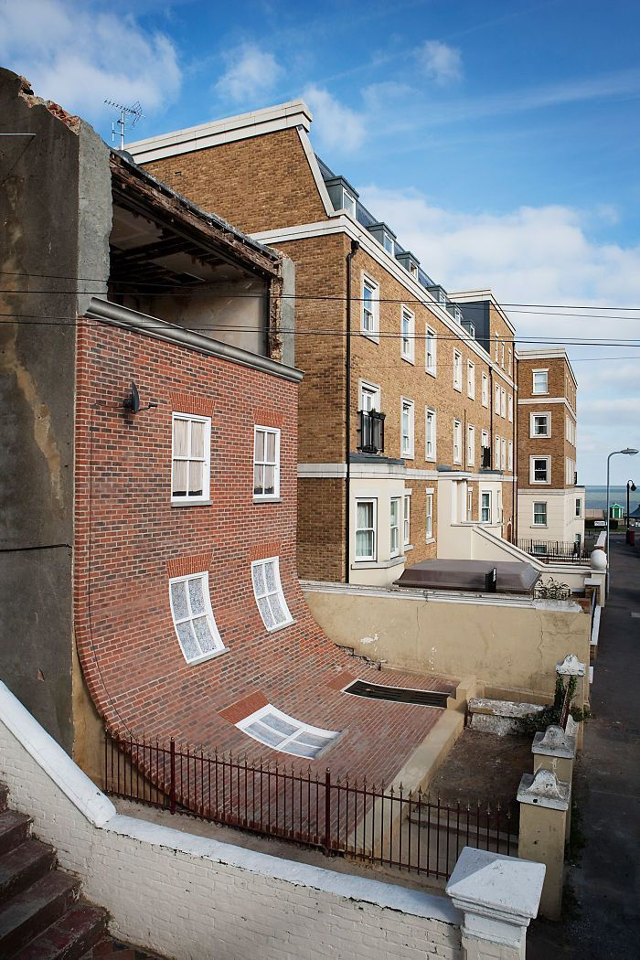 24 Pics Of Reality-Defying Buildings By Alex Chinneck